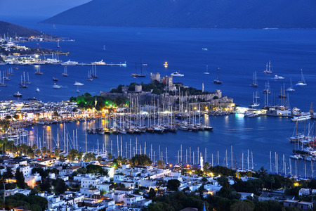 pavo: View of Bodrum harbor and Castle of St. Peter after sunset. Turkish Riviera. Editorial