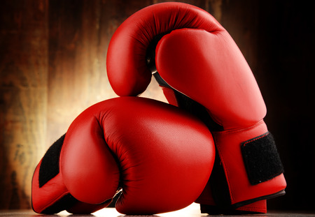 red leather: Pair of red leather boxing gloves