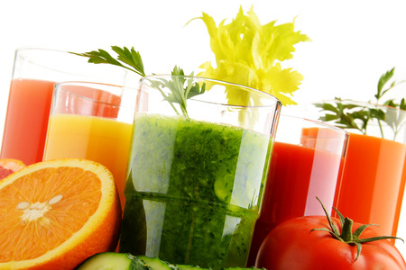 fruit juices: Glasses with fresh organic vegetable and fruit juices isolated on white. Detox diet