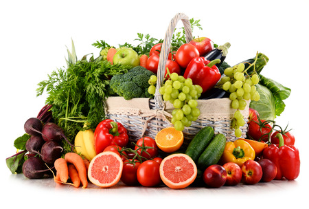 fresh vegetable: Variety of organic vegetables and fruits in wicker basket isolated on white