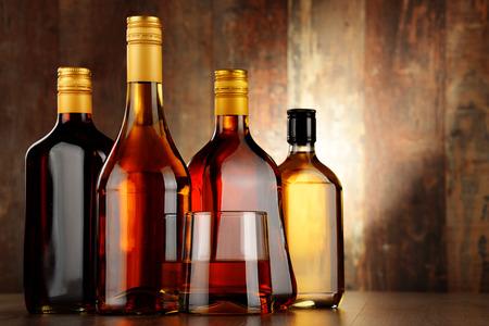 alcohol bottles: Bottles of assorted alcoholic beverages.