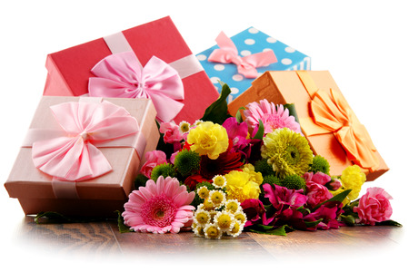 assorted: Composition with bouquet of flowers and gift boxes isolated on white