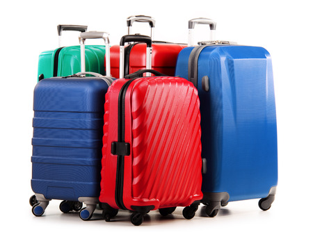 Five plastic suitcases isolated on white.