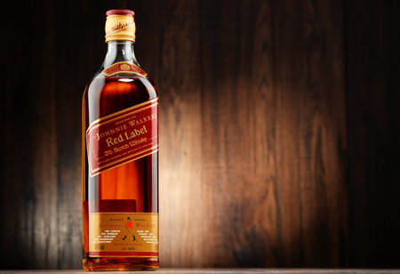 liquors: POZNAN, POLAND - NOVEMBER 4, 2015: Johnnie Walker is the most widely distributed brand of blended Scotch whisky in the world with sales of over 130 million bottles a year.