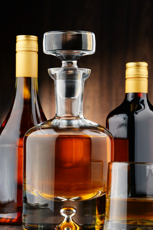 excise: Composition with bottles of assorted alcoholic beverages and glass of whisky Editorial