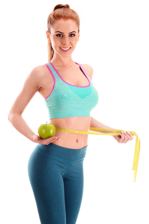 Young woman holding measure tape and apple. Weight loss. 版權商用圖片 - 48198105