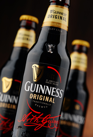 guinness beer: POZNAN, POLAND - NOVEMBER 5, 2015: Irish dry stout, originated in the brewery of Arthur Guinness, Dublin. One of the most successful beer brands in the world, available in over 100 countries