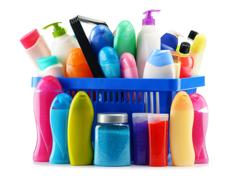 Shopping basket with body care and beauty products isolated on white