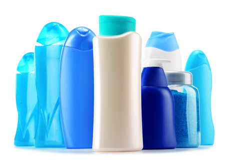Personal Care: Plastic bottles of body care and beauty products isolated on white Stock Photo