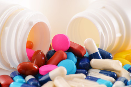 pain killer: Composition with variety of drug pills and container. Stock Photo