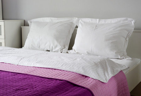 white pillow: Double bed in hotel room. Accommodation