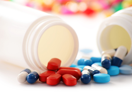 pain killers: Composition with variety of drug pills and container. Stock Photo