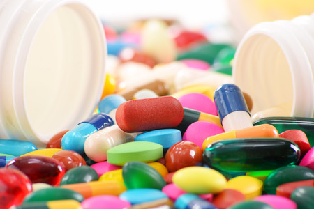 Composition with variety of drug pills and container. Archivio Fotografico