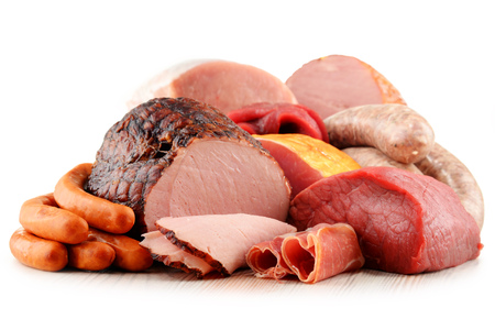 frankfurter: Assorted meat products including ham and sausages isolated on white background