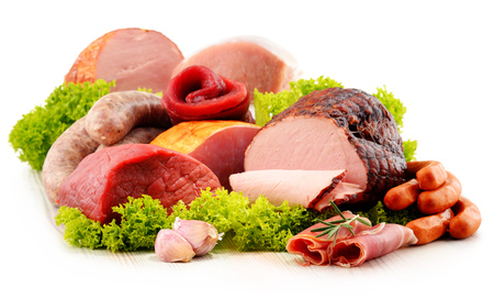 variety: Assorted meat products including ham and sausages isolated on white background