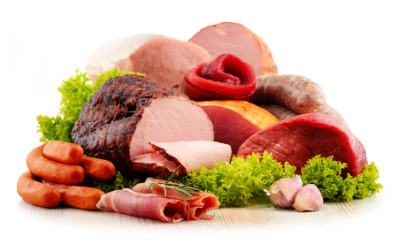 Assorted meat products including ham and sausages isolated on white background Stock fotó - 50048407