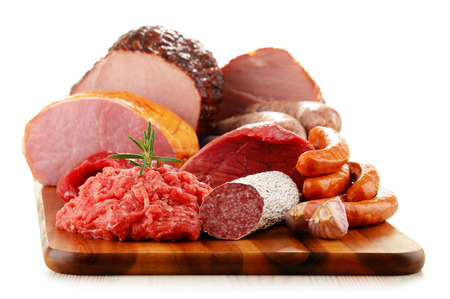 smoked: Assorted meat products including ham and sausages isolated on white background