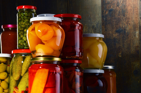 pantry: Jars with pickled vegetables, fruity compotes and jams in cellar. Preserved food