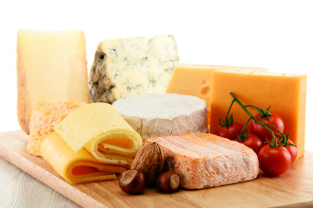 sorts: Different sorts of cheese isolated on white background. Stock Photo