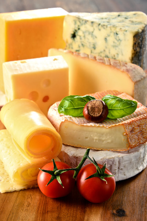 assortment: Different sorts of cheese on kitchen table. Stock Photo