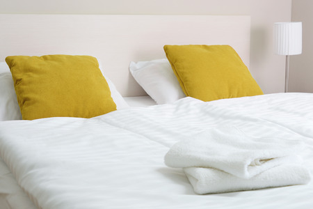 king size bed: Double bed in hotel room. Accommodation.