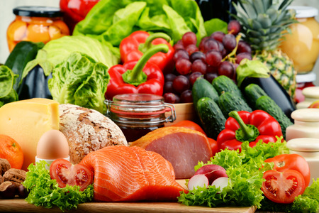 raw vegetables: Variety of organic food including vegetables fruit bread dairy and meat. Balanced diet.