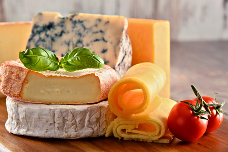 sorts: Different sorts of cheese on kitchen table. Stock Photo