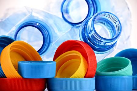 caps: Composición con botellas de plástico y tapas. Foto de archivo