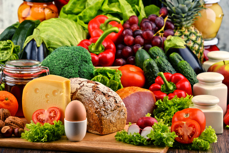 balanced diet: Variety of organic food including vegetables fruit bread dairy and meat. Balanced diet.