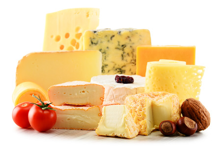 assorted: Different sorts of cheese isolated on white background. Stock Photo
