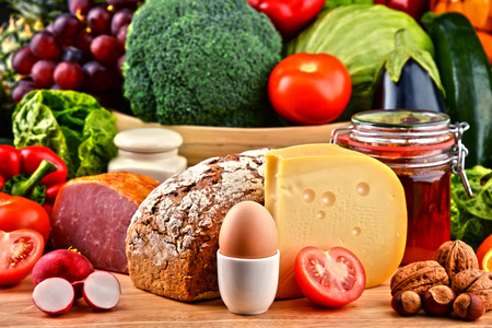 meat diet: Variety of organic food including vegetables fruit bread dairy and meat. Balanced diet.