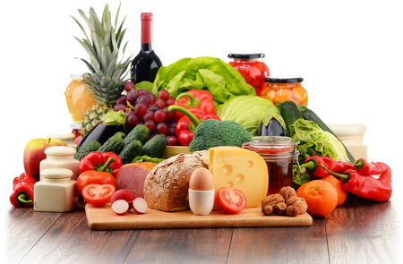 fruit and vegetables: Variety of organic food including vegetables fruit bread dairy and meat. Balanced diet.