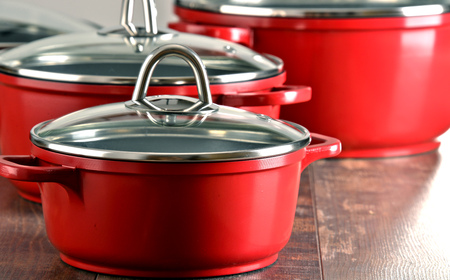 kitchen tool: Composition with four steel kitchen pots