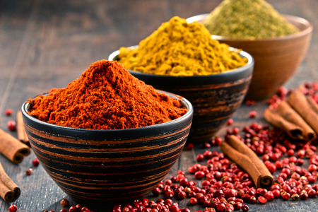 cayenne: Variety of spices on kitchen table. Stock Photo