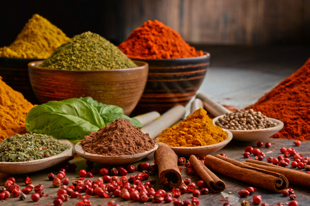 Variety of spices on kitchen table. Archivio Fotografico