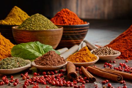 Variety of spices on kitchen table. Standard-Bild