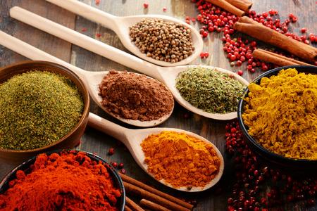 tastes: Variety of spices on kitchen table. Stock Photo
