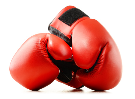 prevalence: Pair of red leather boxing gloves isolated on white background