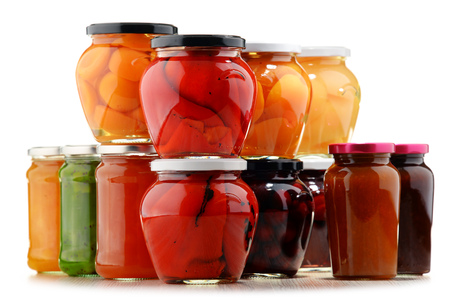 jam jar: Jars with fruity compotes and jams. Preserved fruits. Stock Photo