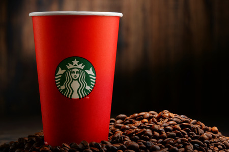 cup coffee: Starbucks coffee cups and beans Editorial