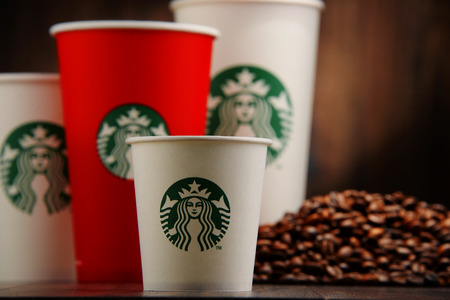 starbucks: Starbucks coffee cups and beans Editorial