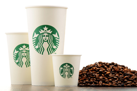 starbucks coffee: Starbucks coffee cups and beans Editorial