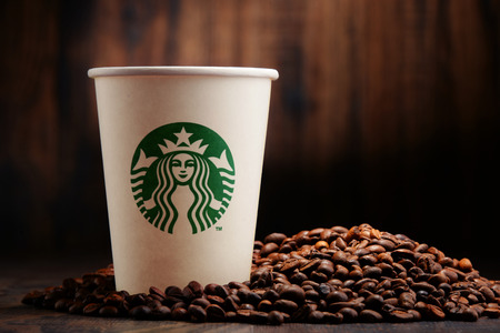 Starbucks coffee cup and beans