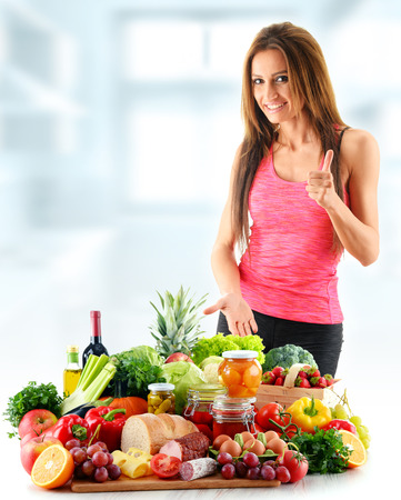 slim woman: Young woman with assorted organic food products. Balanced diet Stock Photo