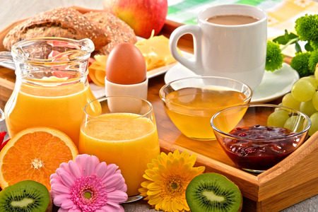 balanced diet: Breakfast on tray served with coffee, orange juice, egg, rolls and honey. Balanced diet.