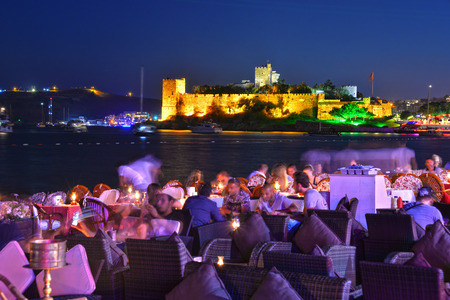 harbour: BODRUM, TURKEY - SEPTEMBER 13, 2015: View of Bodrum harbor and Castle of St. Peter by night. Turkish Riviera. Editorial