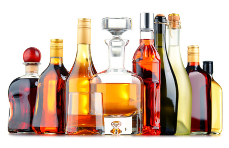 assorted: Composition with bottles of assorted alcoholic beverages.