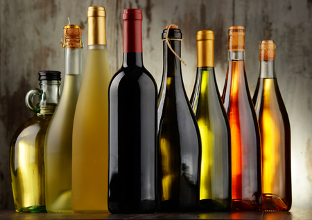 stimulant: Composition with assorted bottles of wine.