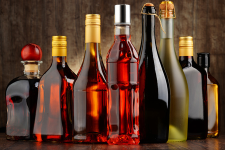 excise: Composition with bottles of assorted alcoholic beverages.