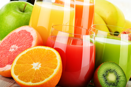 Composition with glasses of assorted fruit juices. Detox diet.